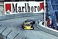 Emerson Fittipaldi - Fittipaldi FD04 leads Rupert Keegan - Hesketh 308E at Tabac at the 1977 Monaco GP.jpg