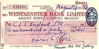"Cheque - An English cheque from 1956 having a bank clerk's red mark verifying the signature, a two-pence stamp duty, and holes punched by hand to cancel it. This is a ""crossed cheque"" disallowing transfer of payment to another account."