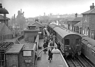 Central line (London Underground) - Standard Stock behind a steam autotrain service at Epping in 1957