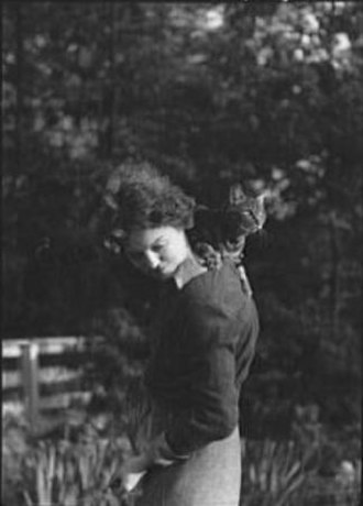 Eva Le Gallienne - Arnold Genthe (1869-1942)/LOC agc.7a00339. Eva Le Gallienne with cat, 1937