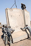 Expanding T-walls at Joint Security Station Loyalty in Baghdad, Iraq DVIDS173714.jpg