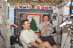 Expedition 8 - Foale and Kaleri conduct a teleconference with Moscow as part of the Russian New Year celebration.(NASA)