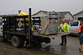 FEMA - 34048 - Workers load a destroyed applicance onto a truck for disposal.jpg