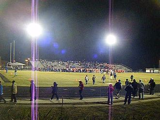 John Randolph Tucker High School - After the Patrick Henry game at Wells Stadium in 2009, fans and players celebrate on the field.