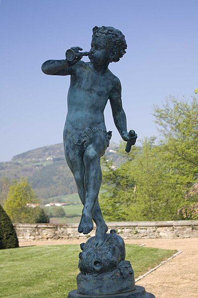 English:  Undin or cherub dancing playing the flute (fountain in the castle park).