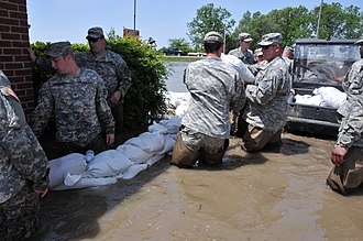 Arkansas National Guard - Arkansas Guard helps fight flood waters in the small community of Payneway, May 2011