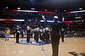 Flickr - Official U.S. Navy Imagery - Lt. j.g. Kelly Cartwright, director of the Navy Band Mid-South, conducts the band during a halftime show at the Memphis Grizzlies and Indiana Pacers game..jpg