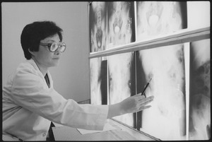 Fort Stewart, Georgia. Female doctor. Major Lucy Cho (Doctor), a radiologist at Womack Army Hospital, studies x-rays... - NARA - 531472.tif