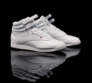 6bb840fc11dc Reebok Freestyle is an athletic shoe style introduced in 1982 by Reebok.  The Freestyle was the first sneaker designed and marketed for women.