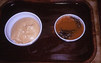 Fufu - Fufu (left) and palm nut soup (right)
