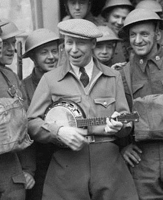 Banjo uke - British musician George Formby with his trademark banjo-ukelele, entertaining British troops in France, 1940