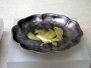 A Tang era gilt hexagonal silver plate with a Fei Lian beast pattern, found from a 1970 excavation in Xi'an. Gilt hexagonal silver plate with a feilian beast pattern.jpg