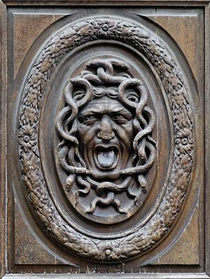 Gorgoneion - A wooden door panel intended to guard the house from an unwelcome guest (Thomas Regnaudin, c. 1660).