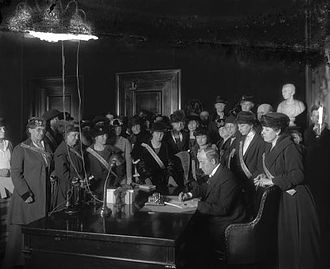 Madeline McDowell Breckinridge - Madeline McDowell Breckinridge stands behind (second from the right) Governor Edwin P. Morrow as he signs Kentucky's ratification of the Nineteenth Amendment.