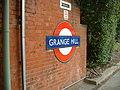 Grange Hill stn roundel1.JPG