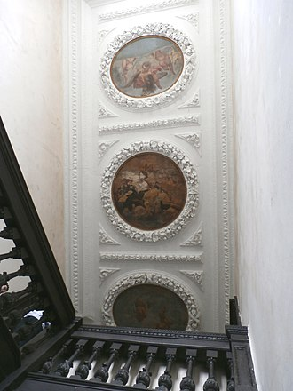 Potheridge - Great Potheridge House, staircase ceiling c.1660-70 with plasterwork wreaths enclosing allegorical paintings with putti, one riding on the back of an  eagle holding a crown in its talons, the middle one of a bare breasted female