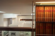 The Guardian's Newsroom visitor centre and archive (No 60), with an old sign with the name The Manchester Guardian