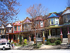 Culture of Baltimore - Some of the more upscale rowhouses in Baltimore, like these brightly painted homes in Charles Village, have complete porches instead of stoops