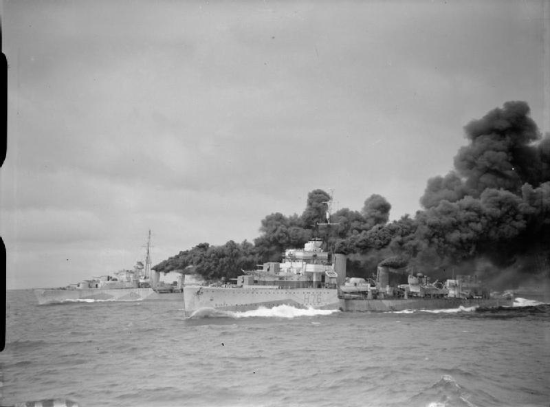 HMS Fury and HMS Ashanti make smoke