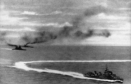 HMS Prince of Wales (left, front) and HMS Repulse (left, rear) under attack by Japanese aircraft. A destroyer is in the foreground. HMS Prince of Wales and HMS Repulse underway with a destroyer on 10 December 1941 (HU 2762).jpg