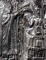 King Harald Blauzahn is baptized (relief on the baptismal font of Tamdrup Kirke)