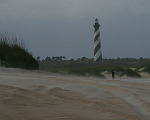 Buxton, North Carolina - A view of the Cape Hatteras Lighthouse from the beach