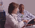 Health professional consults with patient.jpg