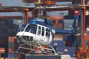 Helijet - A Helijet Bell 206L-1 LongRanger landing on the Vancouver Harbour Helipad.