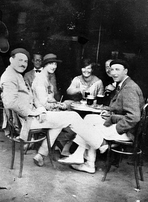 The Sun Also Rises - Hemingway (left), with Harold Loeb, Duff Twysden (in hat), Hadley Richardson, Donald Ogden Stewart (obscured), and Pat Guthrie (far right) at a café in Pamplona, Spain, July 1925. Twysden, Loeb, and Guthrie inspired the characters Brett Ashley, Robert Cohn, and Mike Campbell in The Sun Also Rises.