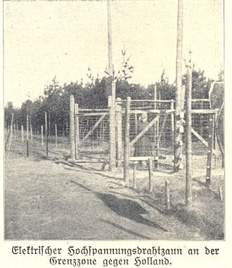 Electrified fence along the border between the Netherlands and Belgium during the First World War. Hochspannungszaun Belgien-Holland 1.jpg