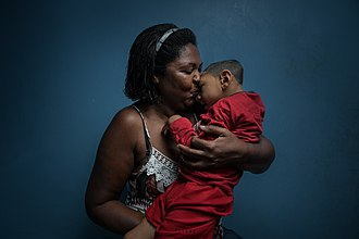 The 2015-16 Zika virus epidemic led to large numbers of children being born with microcephaly, with adoption a frequent outcome. Hold Me Mother, 2018 - Wellcome Photography Prize 2019.jpg