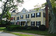 House with trees and shrubberies in Oldwick New Jersey