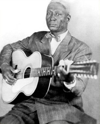 Midnight Special (song) - Lead Belly, photographed by Alan Lomax in the 1940s.