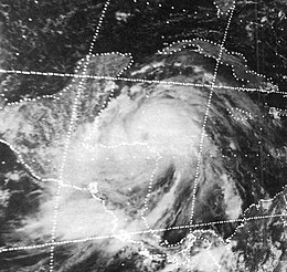 Low-resolution satellite image of a tropical cyclone to the east of Central America