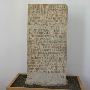 History of writing - Cippus Perusinus, Etruscan writing near Perugia, Italy. The beginning of the writing with the Latin alphabet.