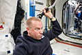 ISS-46 Tim Kopra trims his hair in the Destiny lab.jpg