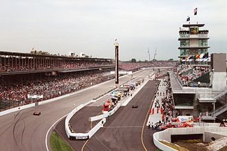 Pit stop - Indianapolis Motor Speedway Formula One pit lane and garages (right) adjacent to the oval racing lane