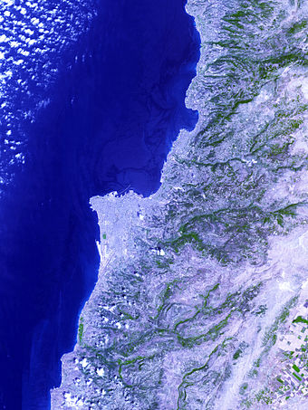 Image from space showing Jiyyeh oil slick in darkest blue, picture centered on Beirut. The largest oil spill in the history of the Mediterranean, it was caused by an Israeli air strike on Jiyeh power station 10 August 2006 Jiyyeh oil spill 2006 NASA ASTER.jpg