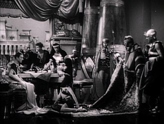 """Cleopatra (1934 film) - """"It was quite difficult to be rolled into a rug and breathe and come out looking pleased with yourself,"""" Colbert remembered. """"We only had to do that scene once."""""""