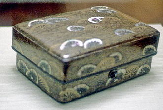 National Treasure (Japan) - Lacquer toiletry case with cart wheels in stream design.