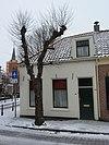 foto van Lage woning met rechte kroonlijst