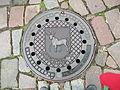 Kaunas COA on a sewage cover.JPG