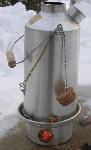 Kelly Kettle - A Kelly Kettle in use. Note the cork stopper is not in the water spout while water is being boiled, this is for safety reasons