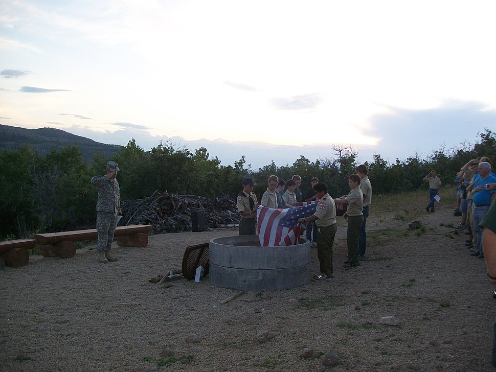 LDS Boy Scouts retireing an American Flag at a scout campout