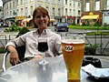 Lady relaxing next to glass of red wine and glass of 1664 beer.jpg