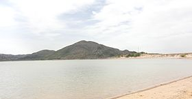 A photo of the Quartz Mountains taken from the shore of Lake Altus