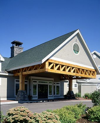 A large timber Howe truss in a commercial building Large Timber Howe Truss.jpg