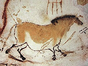 Outline drawing of a horse on a cave wall with yellowish paint on the body and a black mane