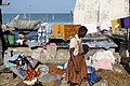 Laundry Hangs in Fishing Village - Outside Cape Coast Castle - Cape Coast - Ghana (4721642270).jpg