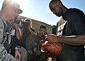 LeBron James signs basketball for Airman.jpg